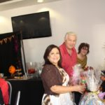 Volunteers Patty Cabrera, Phil Merchant and Laurel Martinez picking out their door prizes. Everyone who attended won a prize!